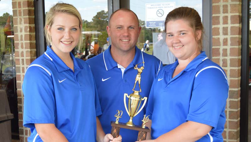 Daily Leader / Chris King / The Wesson Lady Cobras won the District Golf Tournament at Wolf Hollow Monday. Pictured (from left) Kaitlyn Smith, Coach John Douglas and Carrie McSweyn.