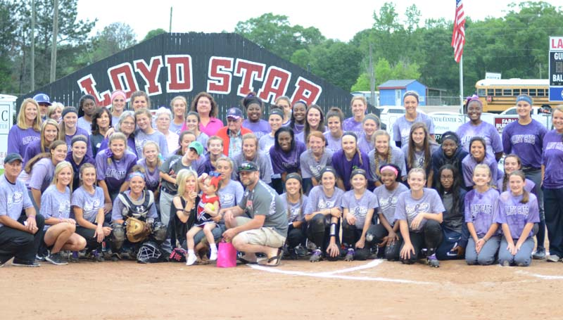 Daily Leader / Marty Albright / The Loyd Star Lady Hornets and the Bogue Chitto Lady Cats pose together with the cancer survivors Tuesday night in the second annual 'Strike Out Cancer' softball contest at the Jan Smith Delaughter Field.