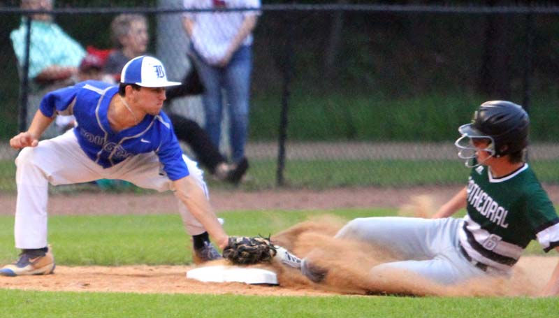 Daily Leader / Sherylyn Evans / Brookhaven Academy Conner Clyde Smith tags out a Natchez Cathedral runner stealing third base Tuesday night at Harold Williams Ballpark.