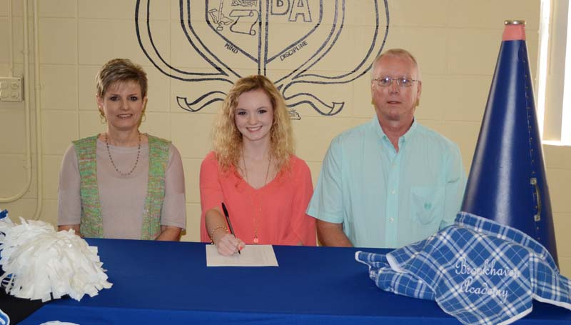 Daily Leader / Marty Albright / Brookhaven Academy's Leah Case has signed with the Copiah-Lincoln Community College Wolves cheer team. Pictured with Case is her mother Pam Case (left) and her father Doug Case.