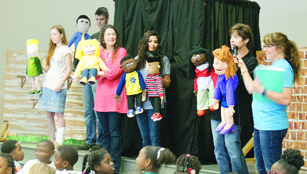 Photo by Aaron Paden / Mamie Martin Elementary School students watch Thursday as Southwest Mississippi Children's Advocacy Center puts on a puppet show to educate them about the types of child abuse and how to report it.