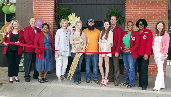 Photo by Amy Rhoads / Roxy Magnolia recently held its ribbon cutting. The consignment and vendor boutique is owned by Greg and Carrie Nettles (center) and is located at 131 W. Cherokee Street. It is opened from 10 a.m. to 5 p.m. Tuesday through Friday and 10 a.m. to 2 p.m. on Saturday.