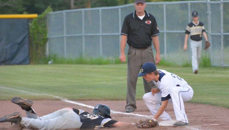Daily Leader / Stacy Leake / Bogue Chitto first baseman Connor Price tags out and Resurrection runner diving back to first on a pick off play Monday night.