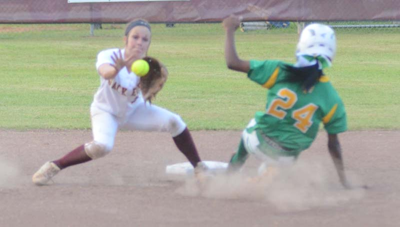 Daily Leader / Marty Albright / Enterprise shortstop Carlee Nations prepares to tag out Taylorsville runner Miracle Crosby (24) sliding into second base Tuesday night at Jerry Coon Field.