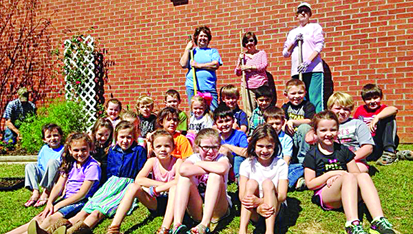 Photo submitted / The Wesson Garden Club helped Julie Lowery's first grade class and Jennie Skinner's kindergarten class plant flowers recently on the Wesson Attendance Center playground.
