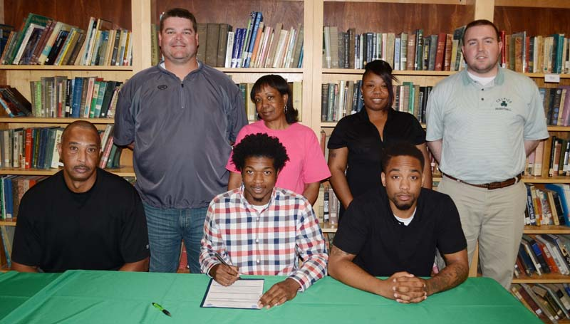 Daily Leader / Marty Albright / West Lincoln senior guard Keshaun London has signed a basketball scholarship with the Southern Union Community College Bison. Pictured with London is (from left) Southern Union men's basketball coach Ron Radford and his older brother Tamarcus London. Standing in the back is West Lincoln basketball coach Lane Young (left), grandmother Rosie Dodds, mother Tatiana London and West Lincoln basketball assistant coach Brooks Smith.