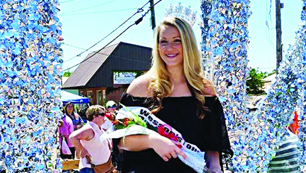 Photo submitted / 2015 Wesson Chamber of Commerce Founders' Day Queen Kaitlyn Smith rides on a float during the 2015 Founders' Day parade.