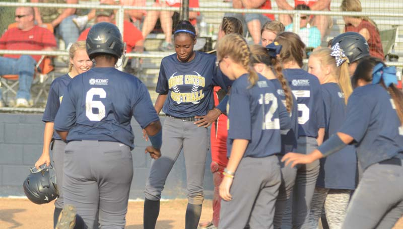 Daily Leader / Marty Albright / Bogue Chitto's Christian Black (6) is greeted at home plate by her teammates after hitting a two-run homerun in the fifth inning against Sebastopol Thursday night.