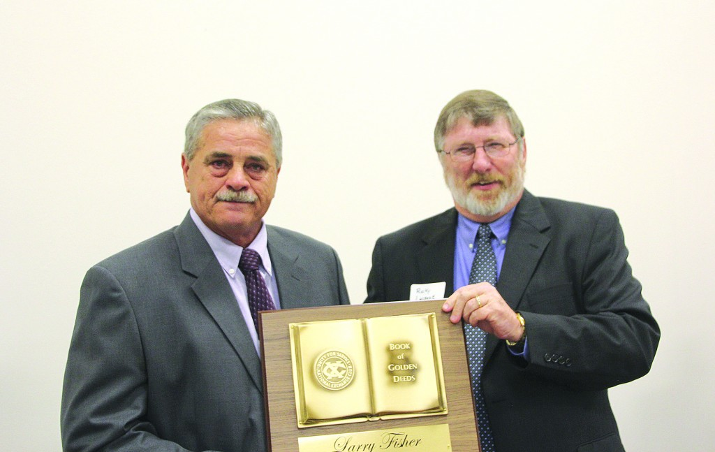 Photo by Alex Jacks/ Larry Fisher was honored with the Golden Deeds award by the Brookhaven Exchange Club Friday night.