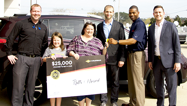 Photo by Alex Jacks / Toyota of Brookhaven recently participated in a car giveaway. Pictured are(from left) Kevin Campbell, internet director; Ruth Heard and her daughter, winner of car; Brian Harmon, CEO of Carlister.com; Dino Evans, sales consultant at Toyota of Brookhaven; and Prentiss Smith general manager at Toyota of Brookhaven.