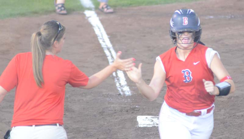 Daily Leader / Marty Albright / Brookhaven's Katherine Shell receives a high-five from her coach Mandy Vinson (left) along third base line after hitting a two-run homerun in the sixth inning against West Harrison.