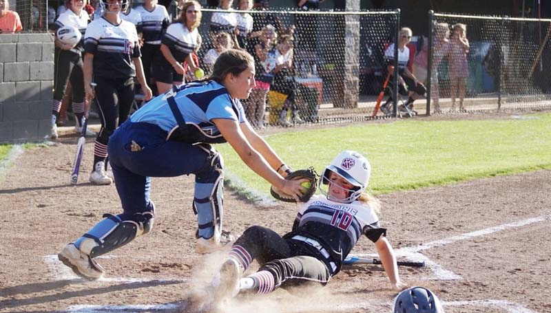 Daily Leader / Jana Harp / Lawrence County's Julianna Johnson slides into home safely under the tag of North Pike catcher Madison Bates.