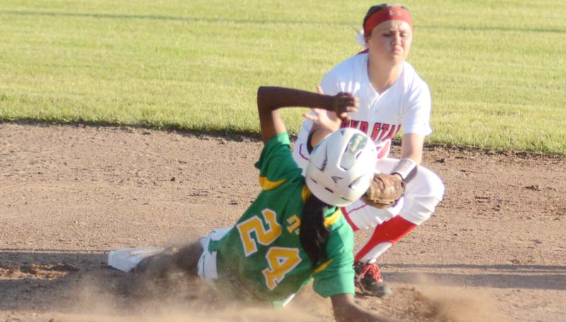 Daily Leader / Marty Albright / Taylorsville's Miracle Crosby (24) slides under the tag of Loyd Star shortstop Abigail Thornton at second base.