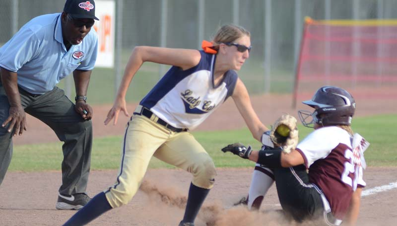 Daily Leader / Marty Albright / Bogue Chitto shortstop Terrah Nelson prepares to make a tag on Smithville runner Callie Williams sliding into third base Thursday.