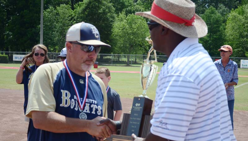 Daily Leader / Marty Albright / Bogue Chitto head coach Scott Leggett receives the Class 1A state runner up trophy from MHSAA director Lonnie Tillman Saturday.
