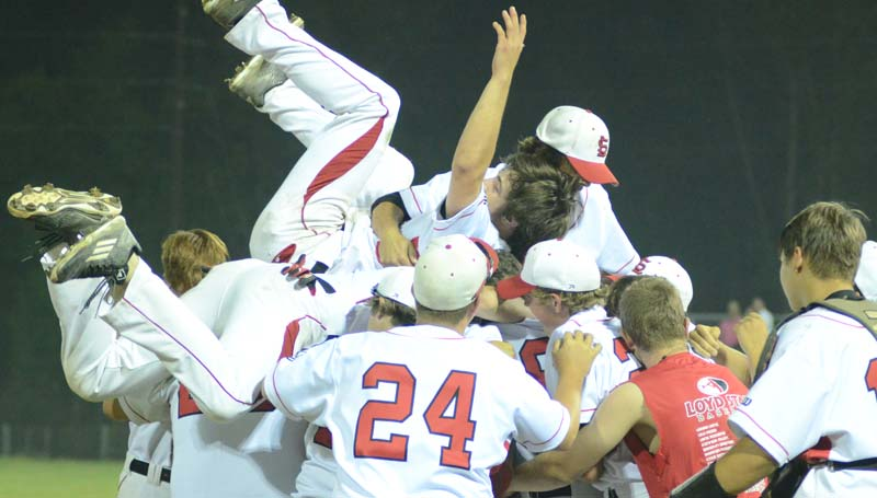 Daily Leader / Marty Albright / The Hornets celebrate their win with a team dog pile after sweeping the Bruins in two games Friday night.