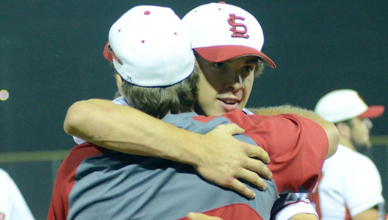 Daily Leader / Marty Albright / Loyd Star head baseball coach Jared Britt and junior Parker Flowers hug after clinching the victory Friday night at Smith Field.