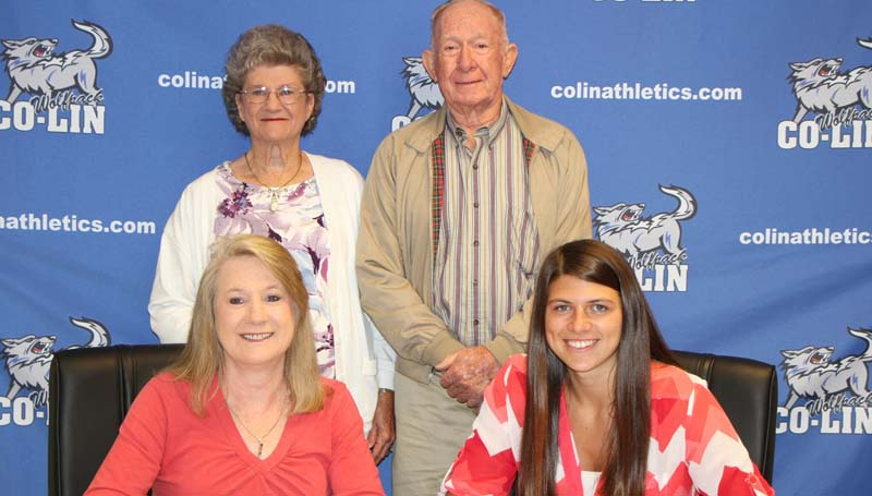 Co-Lin Media / Copiah-Lincoln Community College forward Kelley Allen (seated right) recently signed with the Mississippi College Lady Choctaws of the Gulf South Conference. Allen started in all 28 games for the Lady Wolves. The sophomore from Brandon led the team in scoring with 14.6 points per game and in rebounds averaging 9.1 per game. She shot 50.5 percent from the floor and averaged 2.1 steals and 1.5 blocks per game. Allen was named Mississippi Association of Community and Junior Colleges  (MACJC) First Team All-State and played in the MACJC All-Star Game. She was named MACJC Second Team All-State her freshman season. The Lady Wolves, coached by Gwyn Young and Nikki Williams, finished the 2015-2016 season with a 23-5 record and were the NJCAA Region 23 Runers-Up. Pictured with Allen are her mother, Donna (seated left), and her grandparents Mr. and Mrs. Ray Dearman.