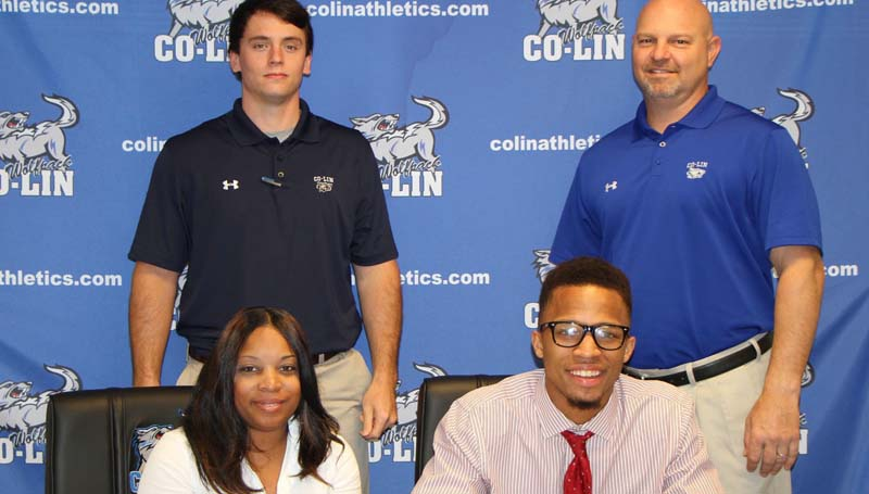 Co-Lin Media / Copiah-Lincoln Community College forward Terik Richardson of Madison (seated right) recently signed with the Belhaven Blazers in the American Southwest Conference. Richardson came off the bench for the Wolves and played in 18 games this season. Richardson shot 33.3 percent from the field and 28.6 percent from beyond the arc. Pictured with Richardson is his mother, Terica Culberson (seated left), Co-Lin Assistant Men's Basketball Coach Jake Reed (standing left) and Co-Lin Head Men's Basketball Coach Kenny Bizot.