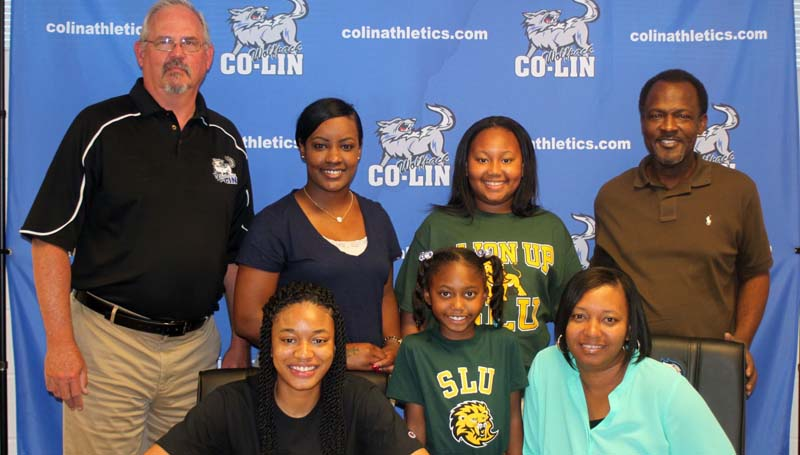Co-Lin Media / Copiah-Lincoln Community College sophomore guard Tytiana Hall of Crystal Springs (seated left) will continue her basketball career at Southeastern Louisiana University in Hammond. Hall averaged 10.9 points per game and five rebounds per game.  Pictured with Hall are mother LaKeshia Hall (seated right); standing from left, Lady Wolves Head Coach Gwyn Young, Lady Wolves Assistant Coach Nikki Williams, sister Symia Jones, sister AniyaJa Blanford, and father J.W. Hall. The Lady Wolves finished the 2015-2016 season with a 23-5 record and were the NJCAA Region 23 Runners-Up.