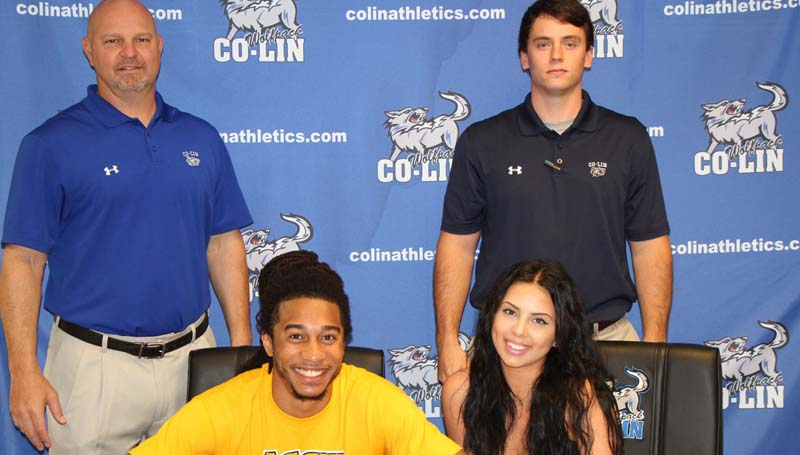 "Co-Lin Media / Copiah-Lincoln Community College guard Donte Watson (seated left) signed with North Carolina A&T State University in Greensboro, NC. The Aggies play in the Mid-Eastern Athletic Conference. The New Orleans native started in 21 games this season for Coach Kenny Bizot's Wolfpack. He shot 41.4 percent from the field and 36.4 percent from three-point range. Watson (6'6"") was the second leading scorer for the Wolves with 15.3 points per game, and second on the team in rebounding with 4.6 per game. He was named Mississippi Association of Community and Junior College (MACJC) Player of the Week twice this season and played in the MACJC All-Star Game. Pictured with Watson are Gabrielle Spears (seated), Head Coach Kenny Bizot (standing left), and Co-Lin Assistant Men's Basketball Caoch Jake Reed."