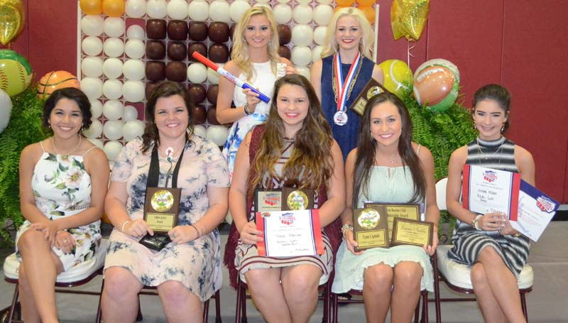 Daily Leader / Marty Albright / The Enterprise Cheerleading team was honored during the school's athletic banquet. Cheeleaders receiving awards were (seated, from left) Adalida Bartholomew, Maddie Carter, Yellow Jacket Award; Taylor Robinson, Captian, Pin it Forward, Leadership; Lauren Nuckles, Captain, All-American; Kinley Miler, All-American; (standing) Carly Polk, Spirit Award and Savanna Dunaway, Pin it Forward, All-American, Best Cheerleader.