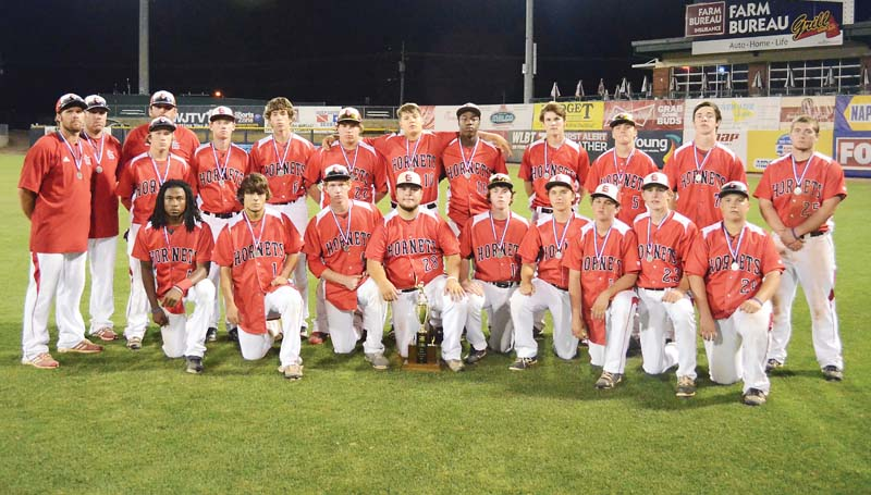 Daily Leader / Photos by Marty Albright / The Loyd Star Hornets pose with the Class 2A state runner-up trophy Saturday at Trustmark Park.