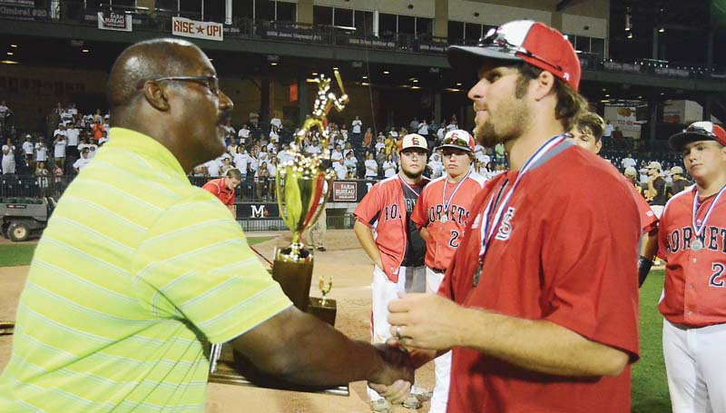 Daily Leader / Loyd Star coach Jared Britt accepts the Class 2A state runner-up tro-  phy from MHSAA Director Lonnie Tillman Saturday.