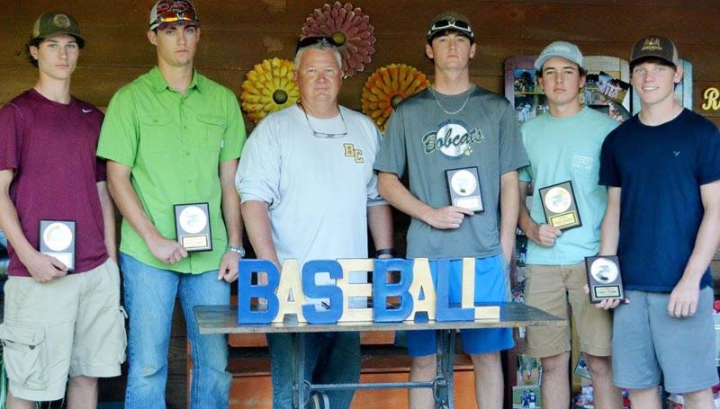 """Daily Leader / Photo submitted / The Bogue Chitto Baseball team was honored during an athletic banquet recently. Players receiving awards were (seated, from left) Trey """"Doc"""" Nettles, Co-Best Defensive Player Award; Tucker Lambert, Co-Best Offensive Player Award; coach Tony Davis; Grant Leake, Co-Best Offensive Player Award; Tanner Gunther, Moundsman Pitcher's Award; and Connor Douglas, Co-Best Defensive Player Award. Not pictured was Rudy Brumfield, Cover the Earth Outfielder's Award, Captain's Award."""