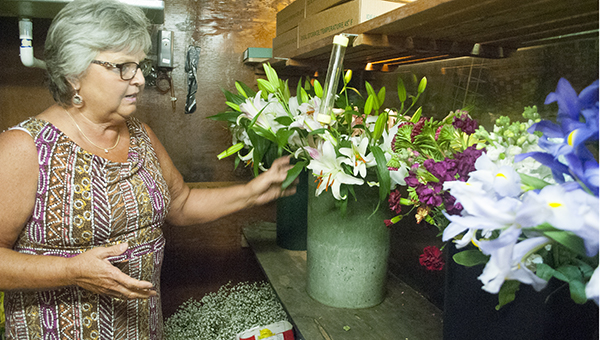 Photos by Julia Miller / Myrtle Cartwright shows off the flowers they have been prepping for two weeks in anticipation of Mother's Day.
