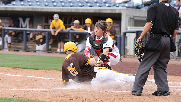 Daily Leader / Amy  Rhoads / Loyd Star catcher Tucker Watts tags out East Union's Ty McDonald (25) sliding into home plate Tuesday in game one of the Class 2A State Championship at Trustmark Park.