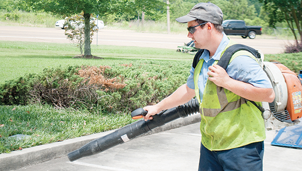 Photo by Aaron Paden / Foreman Westley Forsyth with U.S. Lawns of McComb work to maintain the lawn at Brookhaven Dental Center Friday.