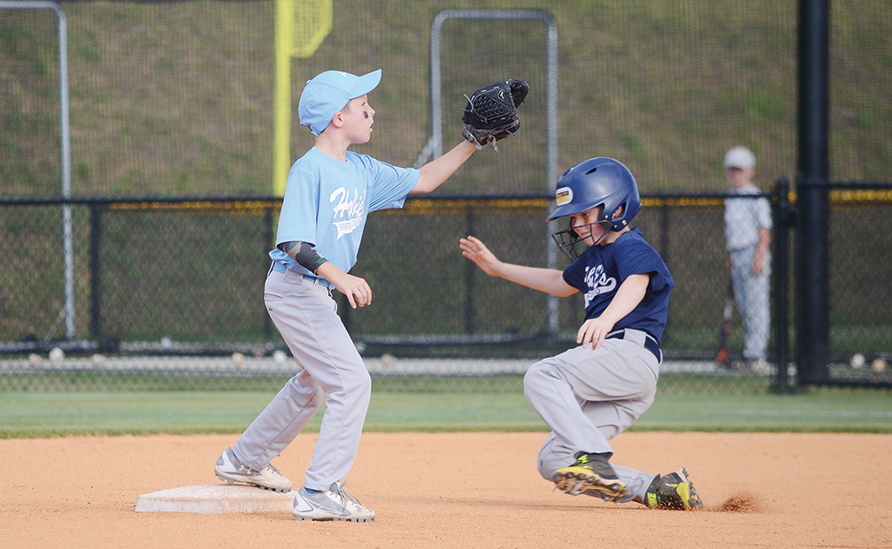 A F&E Frozen H2O baserunner slides safely into second base Monday during the 9- and 10-year-old Dixie Youth Baseball league tournament.  F&E Frozen H2O lost to Hobie's Sports 3-4.  In other 9- and 10-year-old league action, King Fish defeated Stan King 17-5 and Farm Bureau Maroon defeated US Lawns 16-3. In 7- and 8-year-old action, Hobie's Sports defeated Brookhaven Skating Rink 15-4 and Trustmark defeated Riverwood 15-3. In  the 11- and 12-year-old league, Toyota defeated Stan King 10-2 and GT Collision defeated Brookhaven Animal Hospital 11-3. In the 13- and 14-year-old league, Enterprise defeated Loyd Star 6-4 and AJH Gold defeated BA 14-3. Tournament action continues this week.
