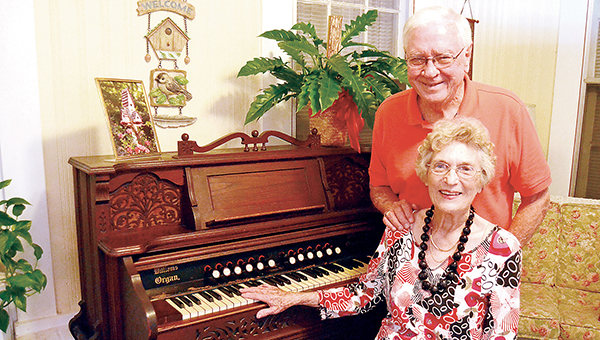 Photo by Donna Campbell/Tom Moak likes to sing hymns while his wife, Willa Moak, plays the antique Parlor Queen organ in their sunroom. The organ, built in the late 1800s, once belonged to Willa Moak's aunt, Nannie Montgomery.