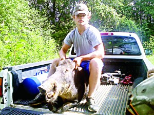 Photo submitted/Bryce Davis of Bogue Chitto loaded a wild boar in his truck after neighbors on Hog Chain Drive shot the 200-pound animal.