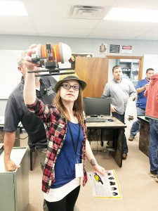 Photo submitted/Lauren Westrope displays a model of the Seawolf V to a group of students touring Copiah-Lincoln Community College Career and Technical Education.
