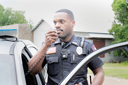 Photo by Aaron Paden/ Jonathan Buie II wears a body camera on his chest Monday during routine police business.