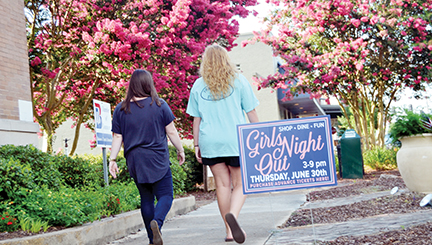 Photo by Donna Campbell/Walkers downtown pass a sign for Girls Night Out in front of the Brookhaven-Lincoln County Chamber of Commerce Wednesday. The sixth annual event, sponsored by the Chamber, is today from 3-9 p.m. at 31 retailers and eateries throughout the city. Tickets are $25 and are available at the Chamber until 6 p.m.