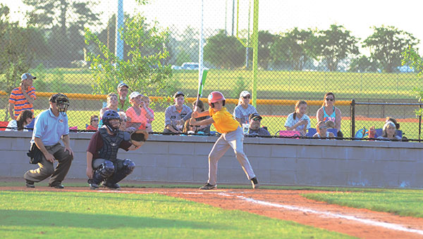 Photo by Anthony  McDougle/  A batter loads up to take a swing at an incoming pitch during the early innings of a 13- and14-year-old Dixie Youth Baseball game at the Lincoln Civic Center Baseball Complex Thursday night. Enterprise won the contest 11-4 in six innings.