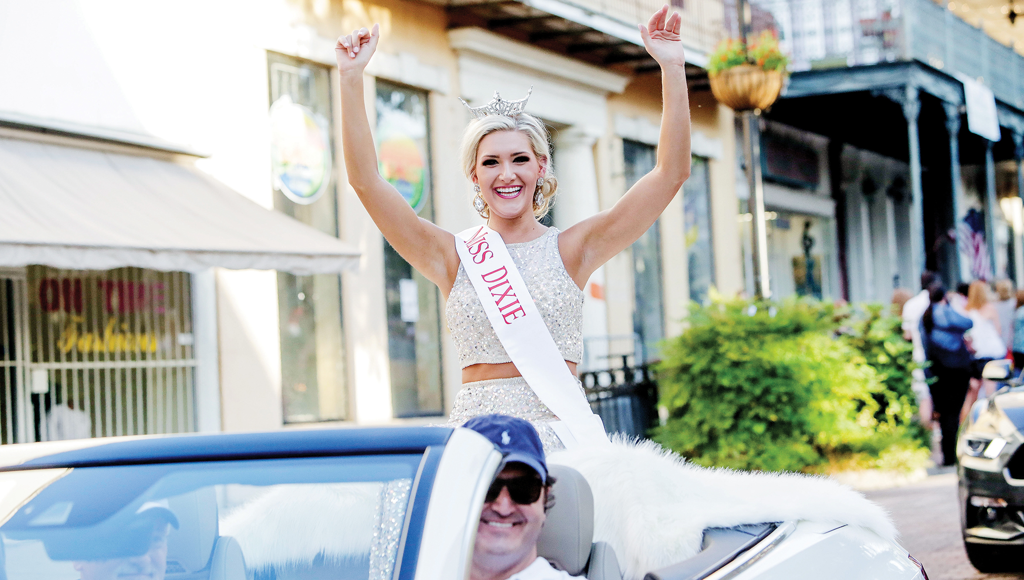 Photo by Alaina Denean Deshazo — The Vicksburg Post/Miss Dixie Laura Lee Lewis of Brookhaven waves to the crowds this week during the parade of Miss Mississippi pageant contestants. The pageant begins tonight in Vicksburg, where Lee's group will compete in the talent portion of the competition.