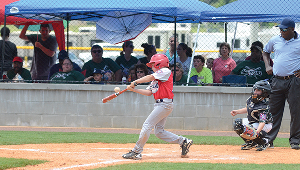 Photo by Anthony McDougle/ American All-Star catcher Bram Wolfe swings and makes contact during his team's first matchup against the Natchez All-Stars. The Lincoln Americans defeated Natchez in their second meeting to avenge a 15-14 loss and be crowned sub-district champions.