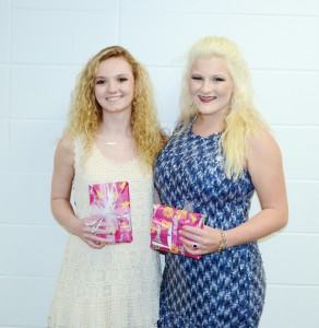 The Brookhaven Academy Cheer squad was honored during their spring athletic banquet. Two senior cheerleaders (from left) Leah Case and Whitney Moak received gifts.