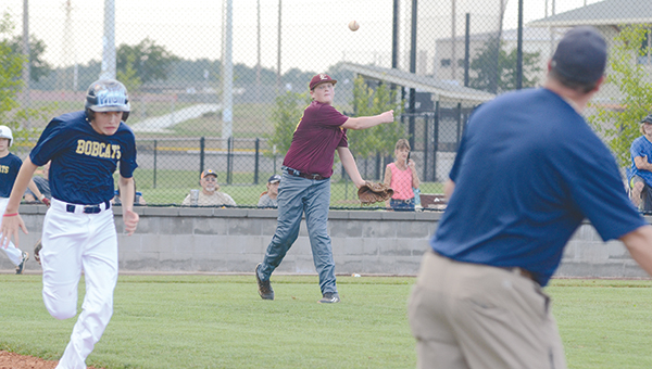 Photo by Anthony McDougle / A Bogue Chitto runner attempts to outrun the throw to first by Enterprise's pitcher during their game on Thursday night at the Lincoln Civic Center Baseball Complex. In walk-off fashion, Enterprise emerged the victor of the contest 5-4.