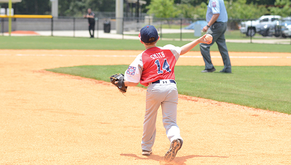 Photo by Anthony McDougle/ American third baseman Graham Smith makes a throw to second during a contest against the Natchez All-Stars at the Lincoln Civic Center Baseball Complex on Saturday. The Lincoln County American All-Stars lost the game 15-14.