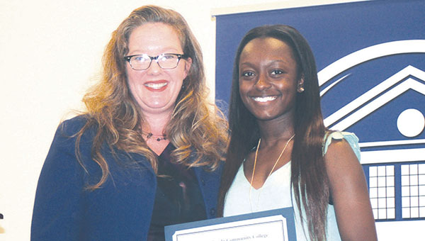 Photo submitted/ Copiah-Lincoln Community College Assistant Dean of Academic Instruction/Chairperson to the HPR Division Stephanie Duguid (left) presents the Outstanding Student-Athlete Award for Women's Soccer to Si'Edriq Middleton of Meadville. The presentation was made during Copiah-Lincoln Community College's recent awards day ceremonies.