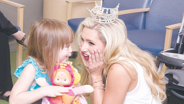 Photos submitted Miss Mississippi Laura Lee Lewis of Brookhaven visits with Lily Manus of Greenville in the lobby of Batson Children's Hospital Tuesday. It was Lewis' first official visit after winning the Miss Mississippi title June 25.