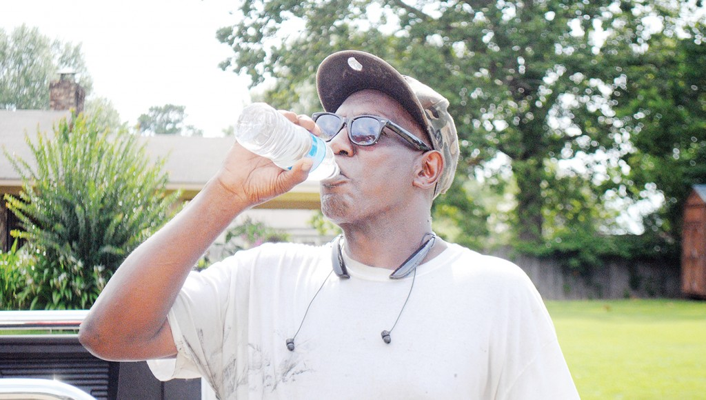 Photo by Aaron Paden/Lawncare worker William Carter stays hydrated Wednesday during a hot day of work. A heat advisory issued for Southwest Mississippi will remain in effect through 7 p.m. today.