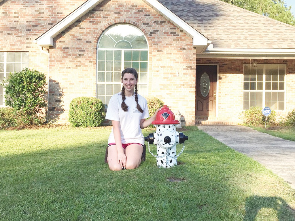 Photo submitted/Anna Katharine Thornton painted the fire hydrant in her grandmother's front yard in Fisher Park to look like a dalmatian firefighter.
