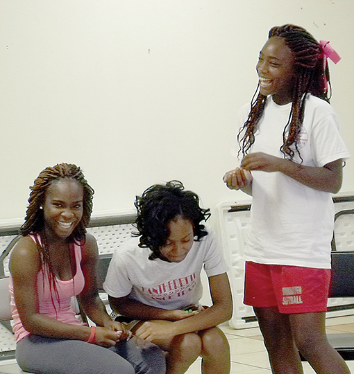 Photos submitted/Nikesha Finley (left), Maria Wilson and Jashuna Finley take a break during a recent monthly workshop hosted by Rising S.T.A.R.S. of Christ, a mentor program in Brookhaven.