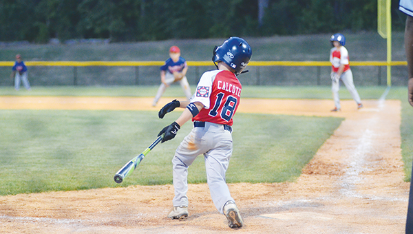 Photo by Anthony McDougle/  Lincoln American All-Stars'  left center fielder Wilson Calcote follows through on his swing in Saturday's contest against Walthall at the Lincoln Civic Center Baseball Complex. The Lincoln Americans won the game 18-16 to force a game three in Walthall on Tuesday.